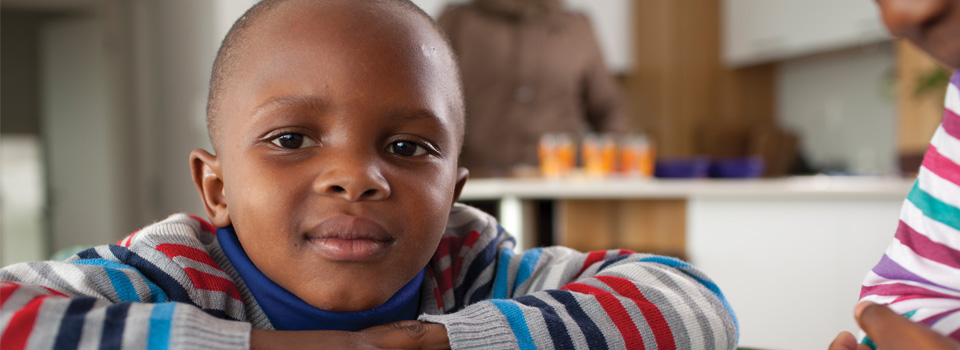 photo of young boy looking directly at you