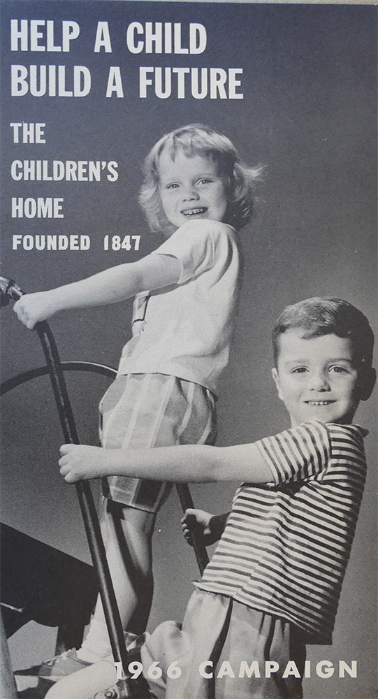 vintage ad with a boy and a girl that says Help a Child Build a Future
