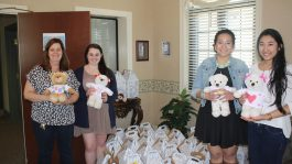 Photo of girls donating teddy bears